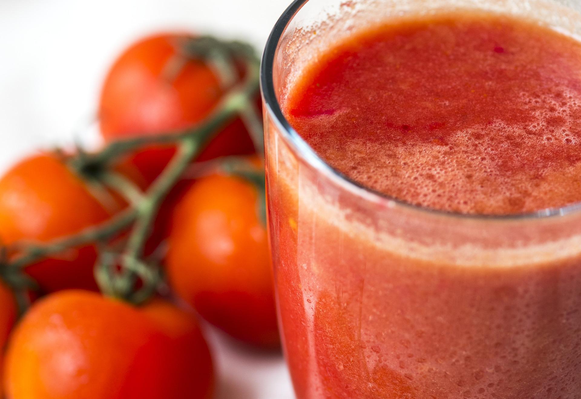 Warm glass of fresh tomato juice